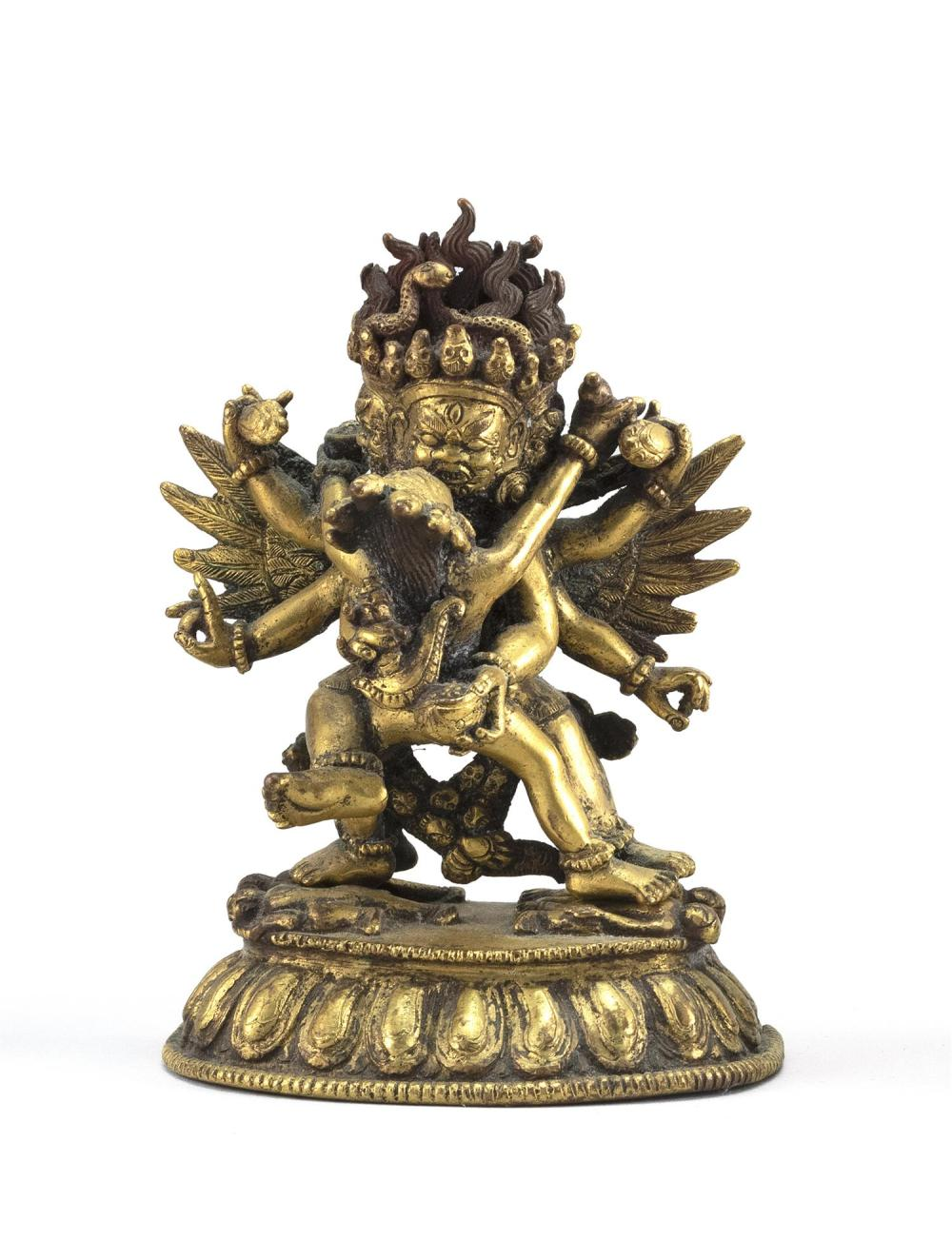 "SINO-TIBETAN GILT-BRONZE FIGURE OF YAMANTAKA WITH HIS CONSORT Dancing on prostrate figures. Height 4""."