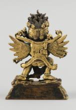 "Lot 968: SINO-TIBETAN GILT-BRONZE FIGURE OF YAMANTAKA WITH HIS CONSORT Dancing on prostrate figures. Height 4""."
