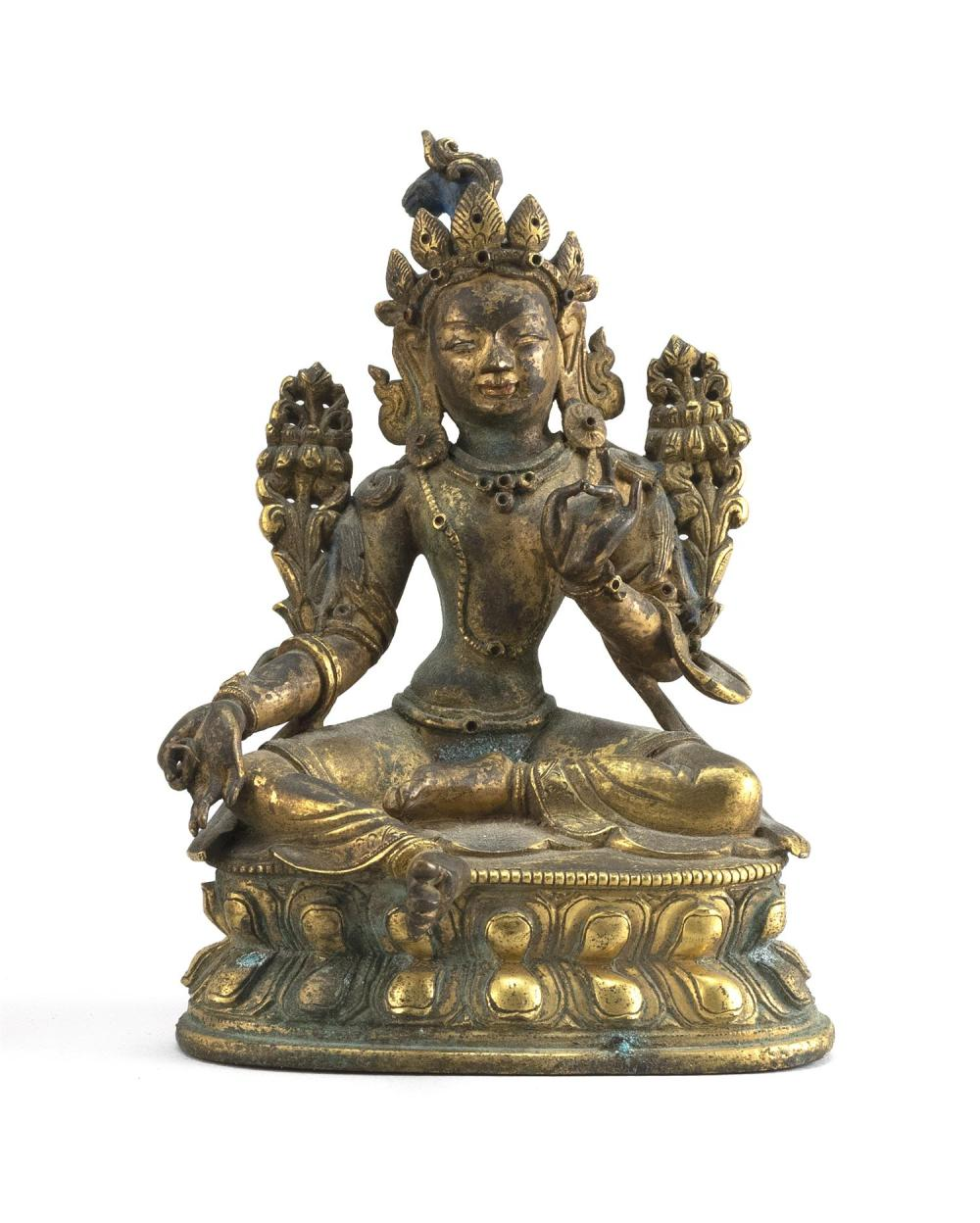 "SINO-TIBETAN GILT-BRONZE FIGURE OF TARA Seated on a double lotus base. Height 4.4""."