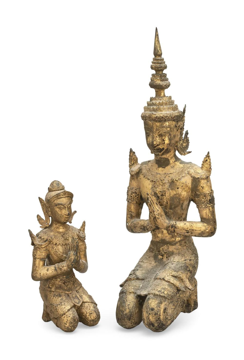 "TWO THAI GILT-BRONZE FIGURES OF KNEELING BUDDHAS Heights 10"" and 19.5""."