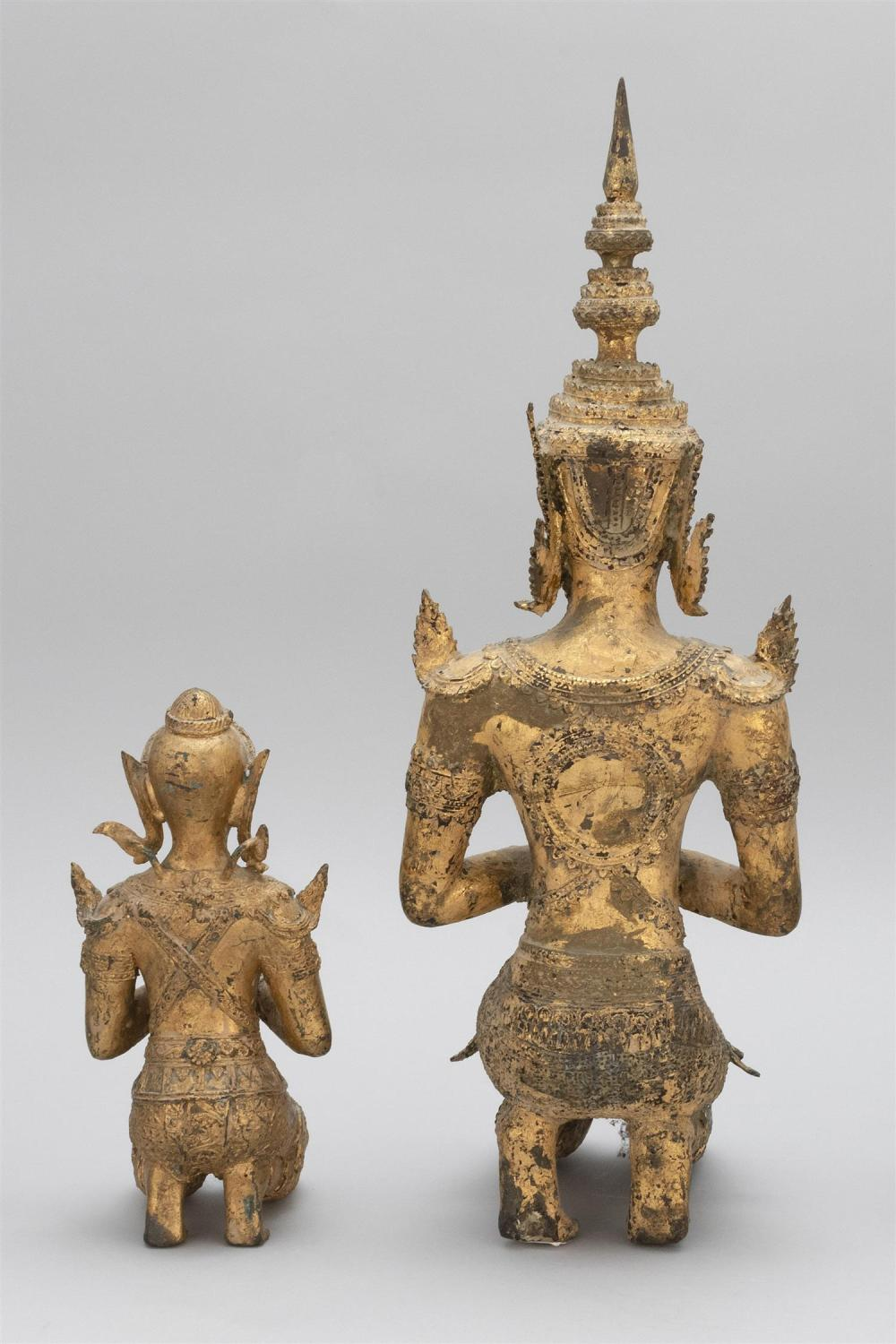 """Lot 972: TWO THAI GILT-BRONZE FIGURES OF KNEELING BUDDHAS Heights 10"""" and 19.5""""."""