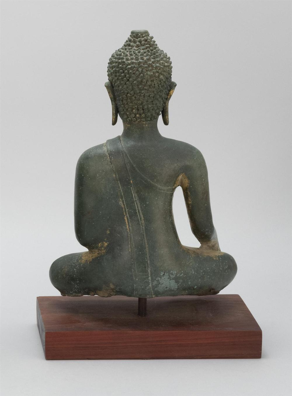 "Lot 973: THAI GILT-BRONZE FIGURE OF BUDDHA Seated in earth touching position. Open ushnisha; no flame finial. Height 13""."