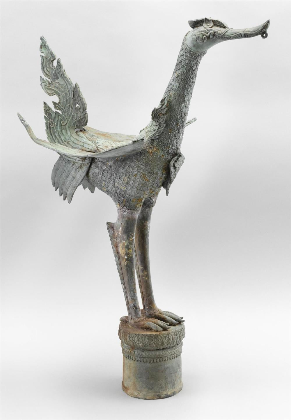 "THAI BRONZE FINIAL In the form of a bird standing on a rain drum. Height 22.75""."