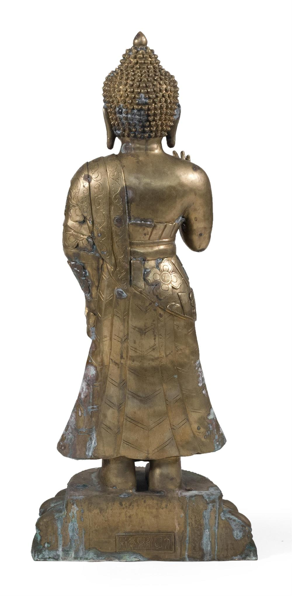 """Lot 976: CHINESE BRONZE FIGURE OF BUDDHA Standing and with a tightly curled top knot and flowing robes. Height 45.5""""."""