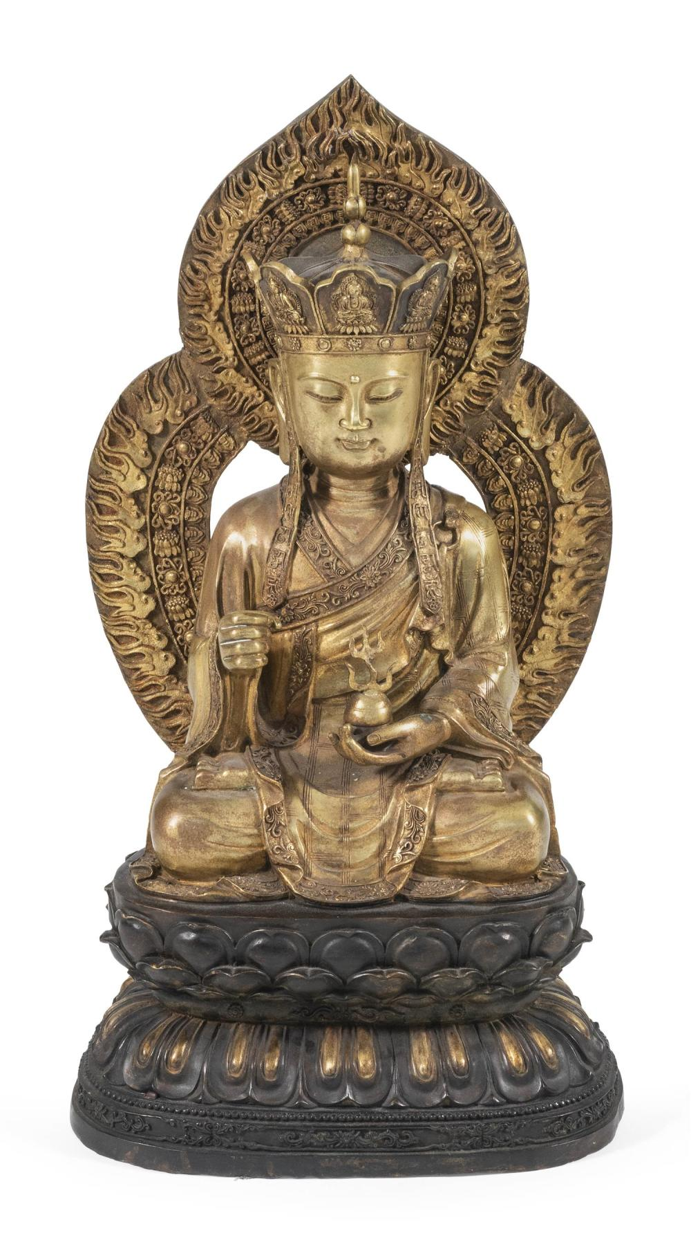 "CHINESE GILT-BRONZE FIGURE OF BUDDHA Seated on double lotus throne, holding a sensor and wearing a monk cap crown. Height 28""."