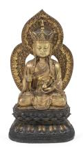 """Lot 977: CHINESE GILT-BRONZE FIGURE OF BUDDHA Seated on double lotus throne, holding a sensor and wearing a monk cap crown. Height 28""""."""