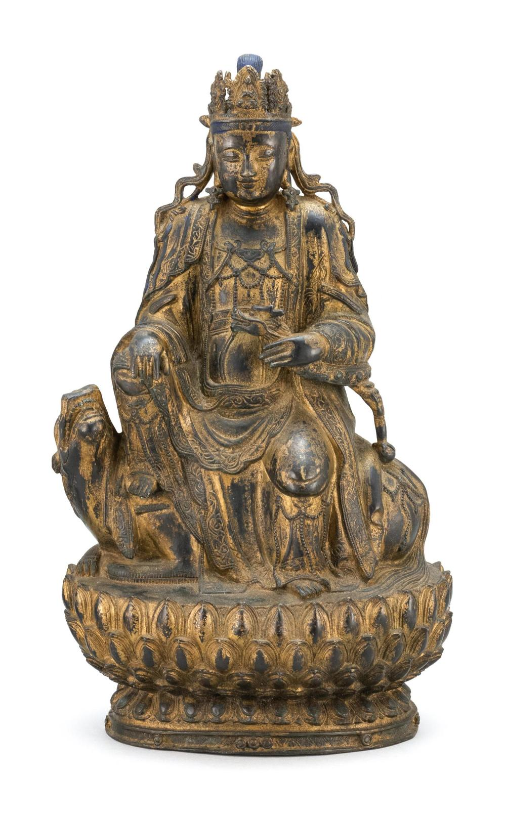 CHINESE PARTIAL-GILT FIGURE OF BUDDHA Seated on a guardian lion atop a two-tier lotus base. Traces of gilding and polychroming. Heig...