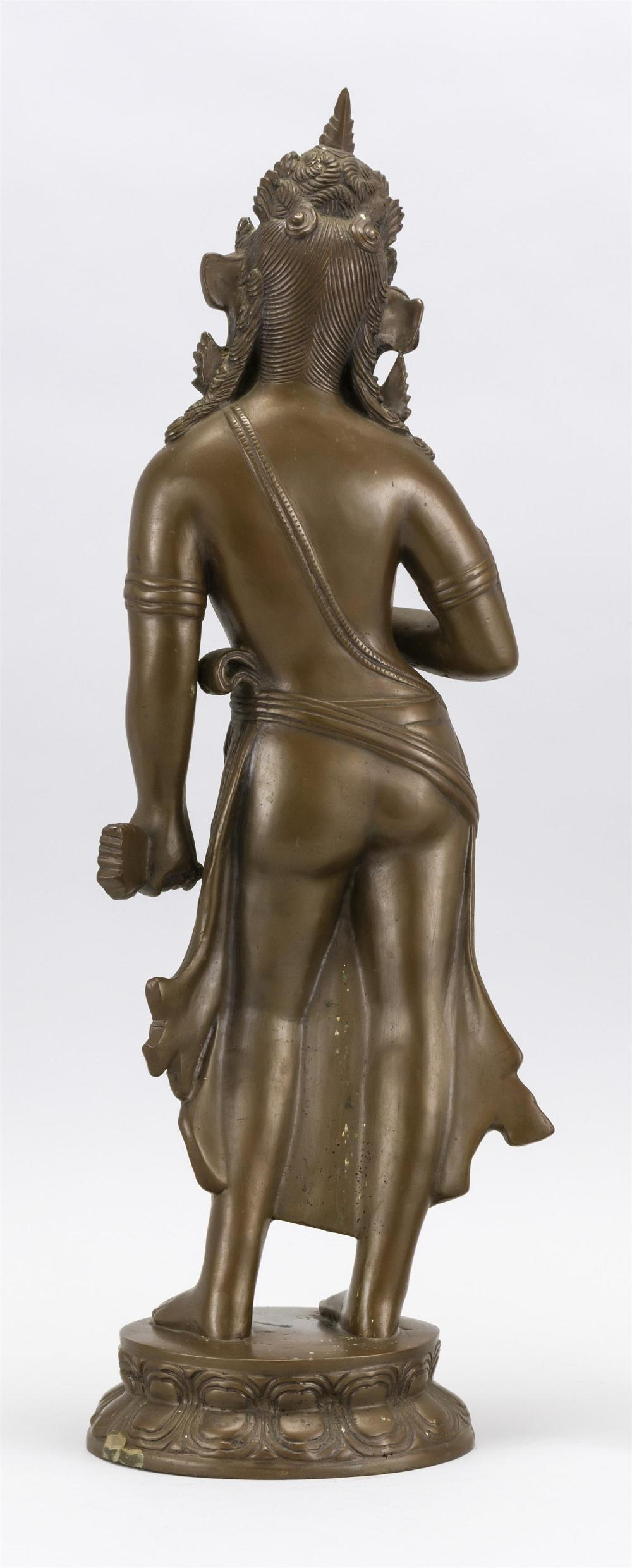 "Lot 979: INDIAN BRONZE FIGURE OF TARA Standing on a lotus base. Height 19.5""."
