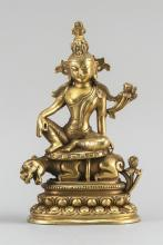 """Lot 980: CHINESE GILT-BRONZE FIGURE OF A DEITY Seated on a tiger atop a double lotus base. Height 8.5""""."""