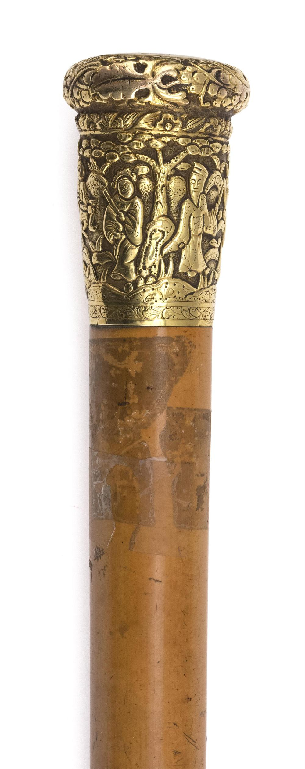 """Lot 985: CHINESE WALKING STICK WITH 14KT GOLD HEAD With repoussé figural landscape design. Monogramed """"HND"""". Length 34""""."""