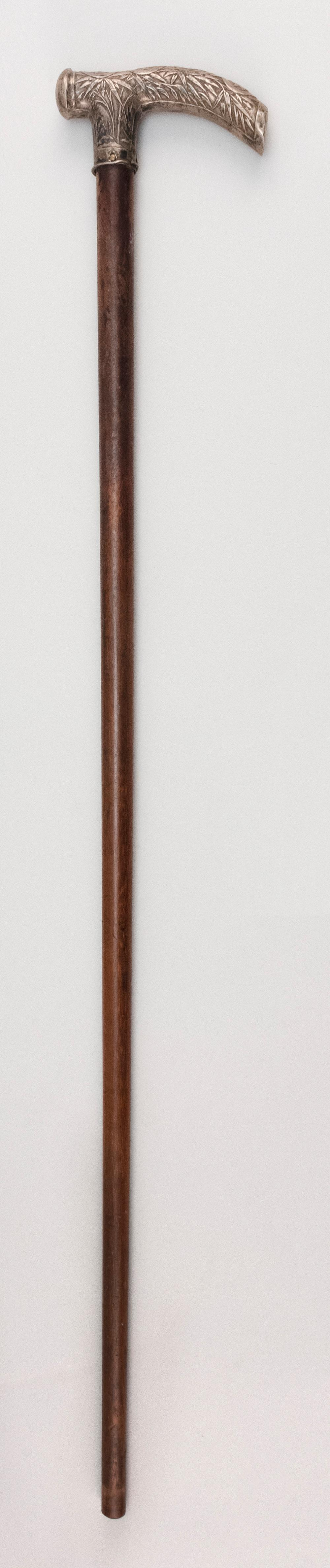 "CHINESE EXPORT SILVER AND WALNUT CANE With bamboo and calligraphic design. Length 31.5""."
