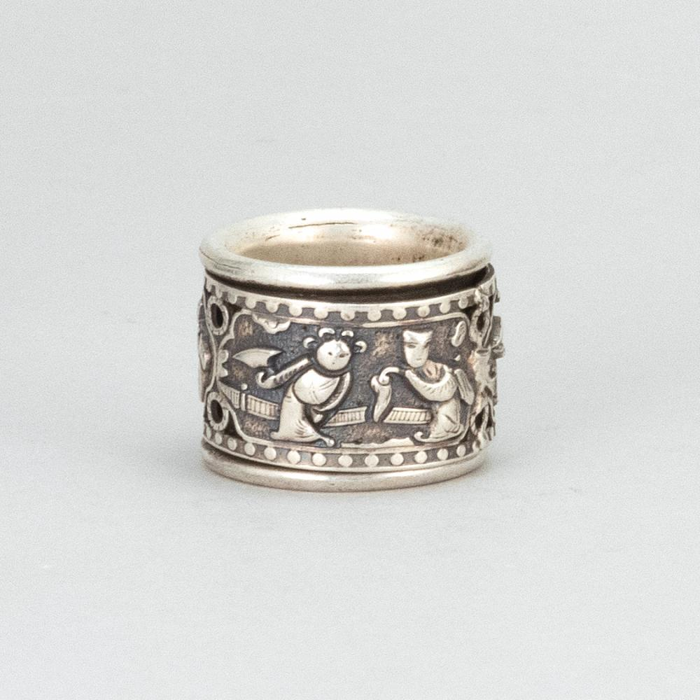 CHINESE SILVER THUMB RING With articulated repoussé figural band. Silver mark on interior.