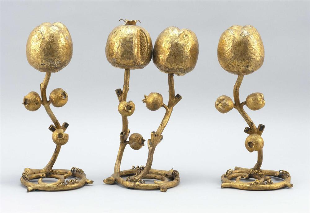 SET OF THREE CHINESE GILT-BRONZE ALTAR ORNAMENTS In the form of pomegranates on twisted stems. One double and two single. Some eleme...