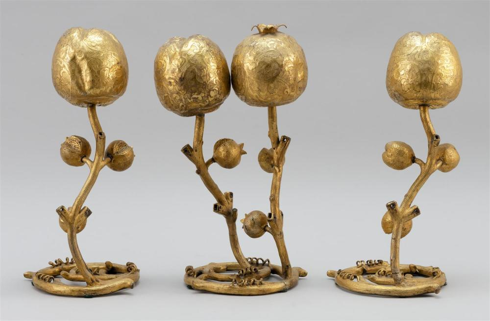 Lot 996: SET OF THREE CHINESE GILT-BRONZE ALTAR ORNAMENTS In the form of pomegranates on twisted stems. One double and two single. Some eleme...