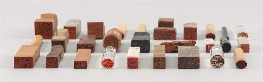 Lot 998: TWENTY-NINE ASSORTED SEALS Seventeen wood or bamboo, seven soapstone, three crystal and two lacquer.