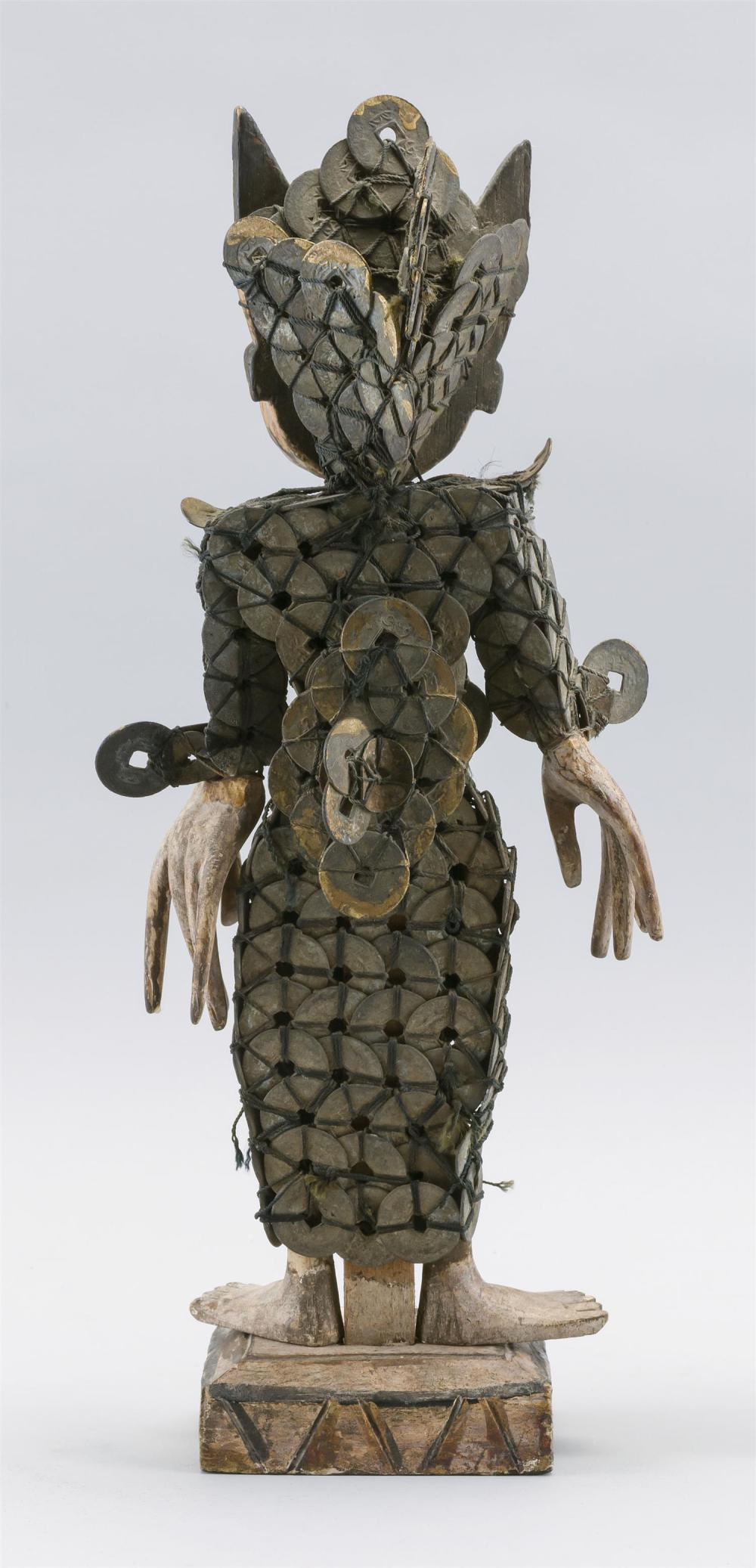 """Lot 1000: SOUTHEAST ASIAN WOOD AND COIN FIGURE OF A HORNED DEMON Standing on a platform. Height 5""""."""