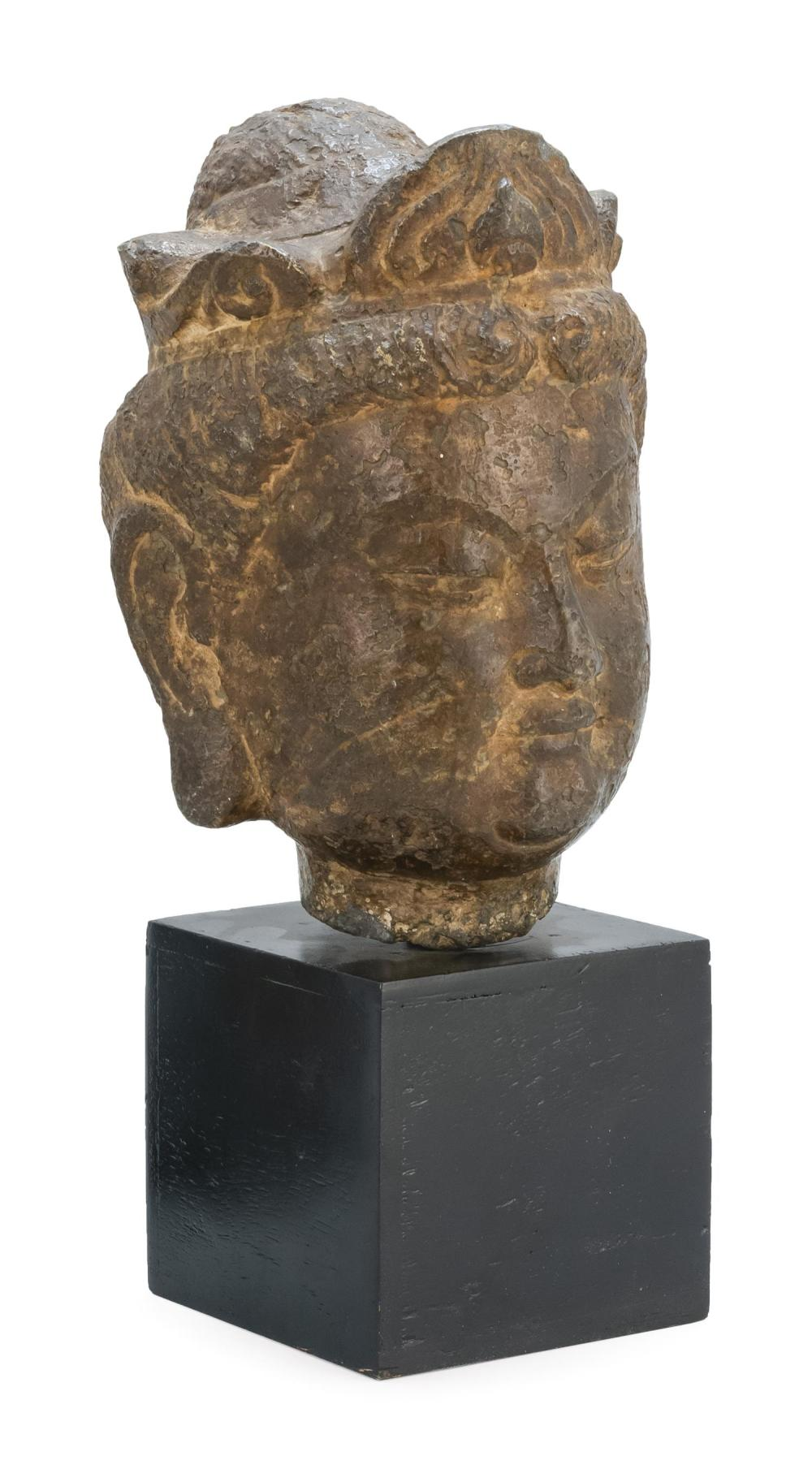 "STONE HEAD OF BUDDHA Wearing a pearl-decorated crown. Height 10"". Ex Collection: Sackler Museum."