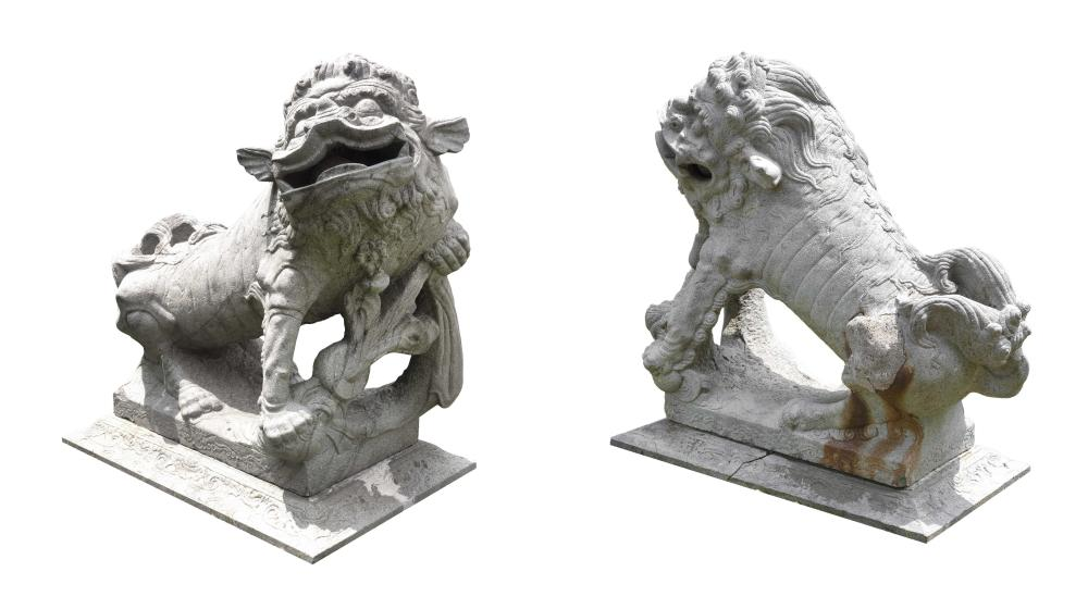 "Lot 1005: PAIR OF CHINESE GRANITE LION FIGURES One guarding a cub and the other guarding a ball. Heights 40"". Lengths 34"". From the grounds of..."