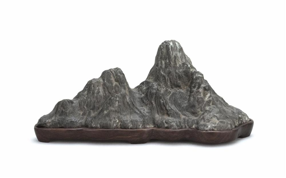 "CHINESE BLACK STONE SCHOLAR'S ROCK In mountain range form. Wood base. Length 13.25""."