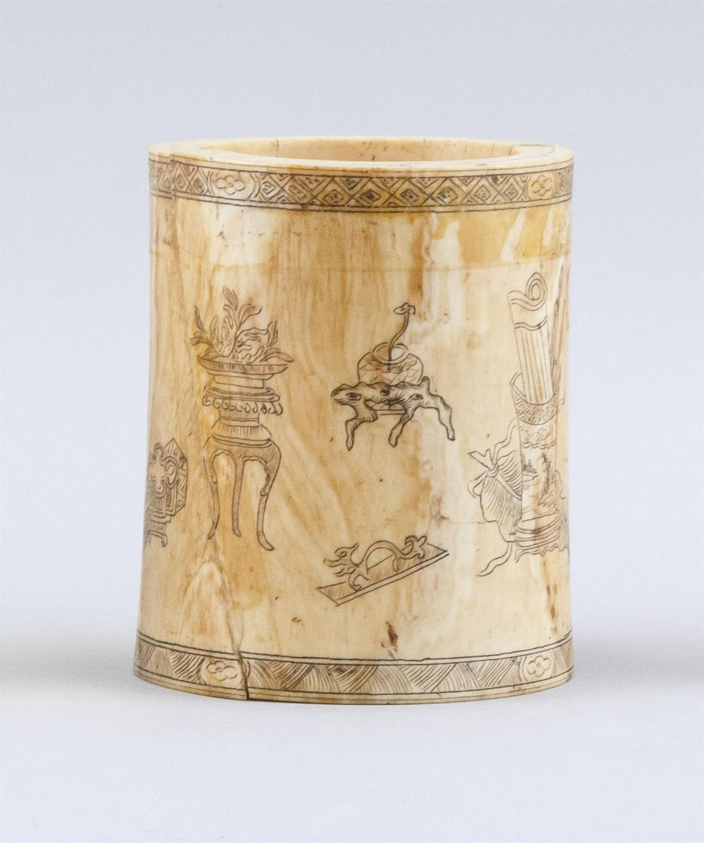 "CHINESE IVORY BRUSH POT Cylindrical, with decoration of scholars' objects and calligraphy. Height 4.75"".Not available for internatio.."