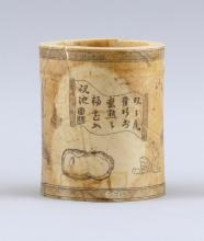 """Lot 1011: CHINESE IVORY BRUSH POT Cylindrical, with decoration of scholars' objects and calligraphy. Height 4.75"""".Not available for internatio.."""