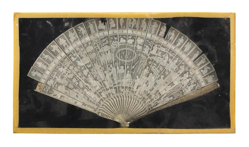 "CHINESE EXPORT IVORY FOLDING BRISÉ FAN With figural landscape. Housed in a shadow box frame. 8"" x 15"". Not available for internation..."