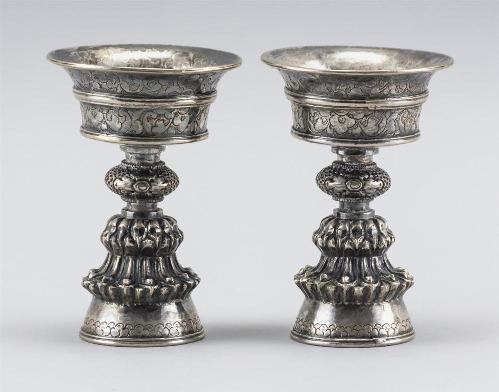 "PAIR OF SINO-TIBETAN SILVER FAT LAMPS OR ALTER CUPS Unmarked. Heights 4"".Approx. 6.1 troy oz."