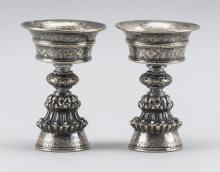 """Lot 1019: PAIR OF SINO-TIBETAN SILVER FAT LAMPS OR ALTER CUPS Unmarked. Heights 4"""".Approx. 6.1 troy oz."""