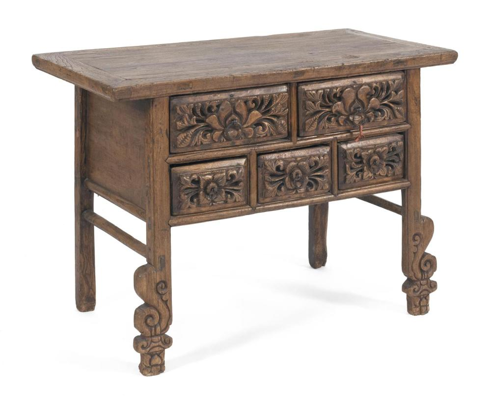 "CHINESE SHANXI CARVED ELMWOOD TABLE With five heavily carved drawer fronts and similar carving at lower half of legs. Height 34"". Wi..."