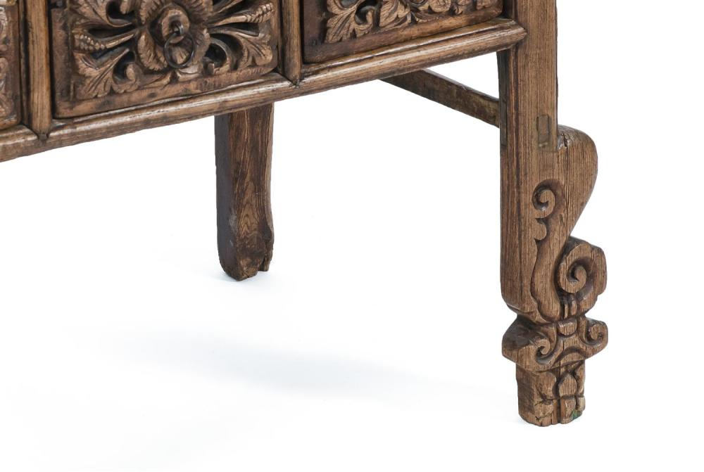 """Lot 1028: CHINESE SHANXI CARVED ELMWOOD TABLE With five heavily carved drawer fronts and similar carving at lower half of legs. Height 34"""". Wi..."""
