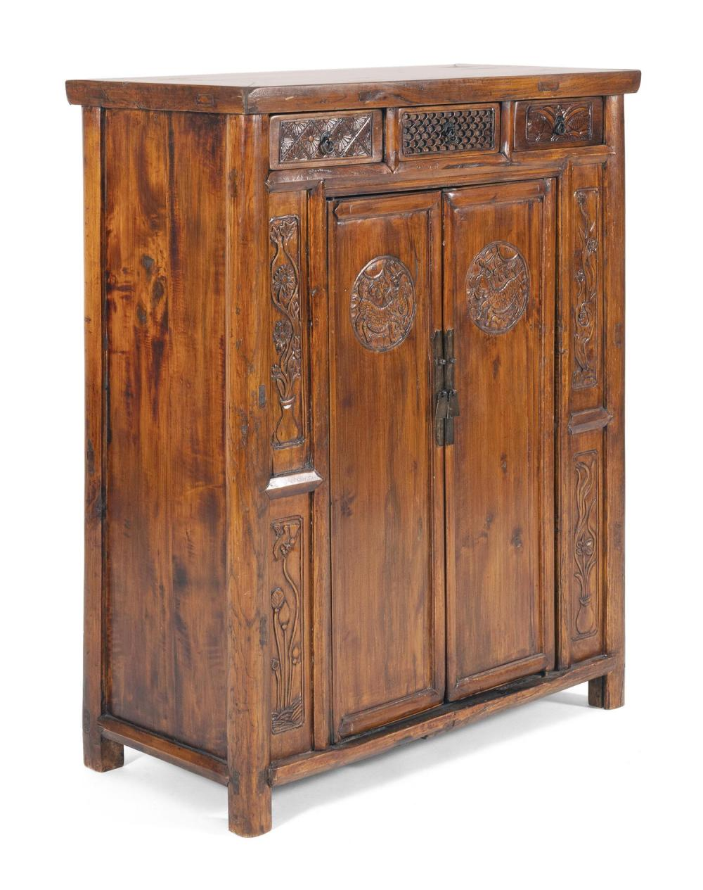 CHINESE ROSEWOOD CUPBOARD With three carved drawers over a two-door cabinet that opens to reveal two interior shelves separated by t...