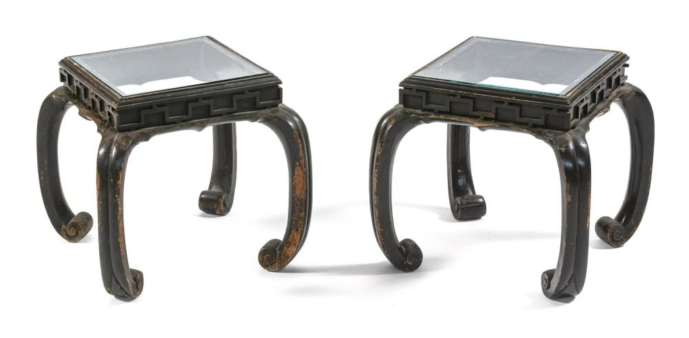 "PAIR OF CHINESE BLACK LACQUERED WOOD STANDS Square, with curved legs and replaced glass tops. Heights 12"". Tops 10"" x 10""."