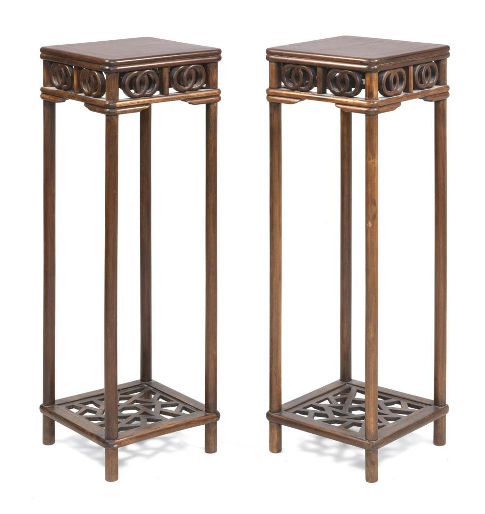 "PAIR OF CHINESE ELMWOOD TALL STANDS With openwork aprons and cracked ice shelf at foot. Heights 35.5"". Tops 11.75"" x 11.75""."
