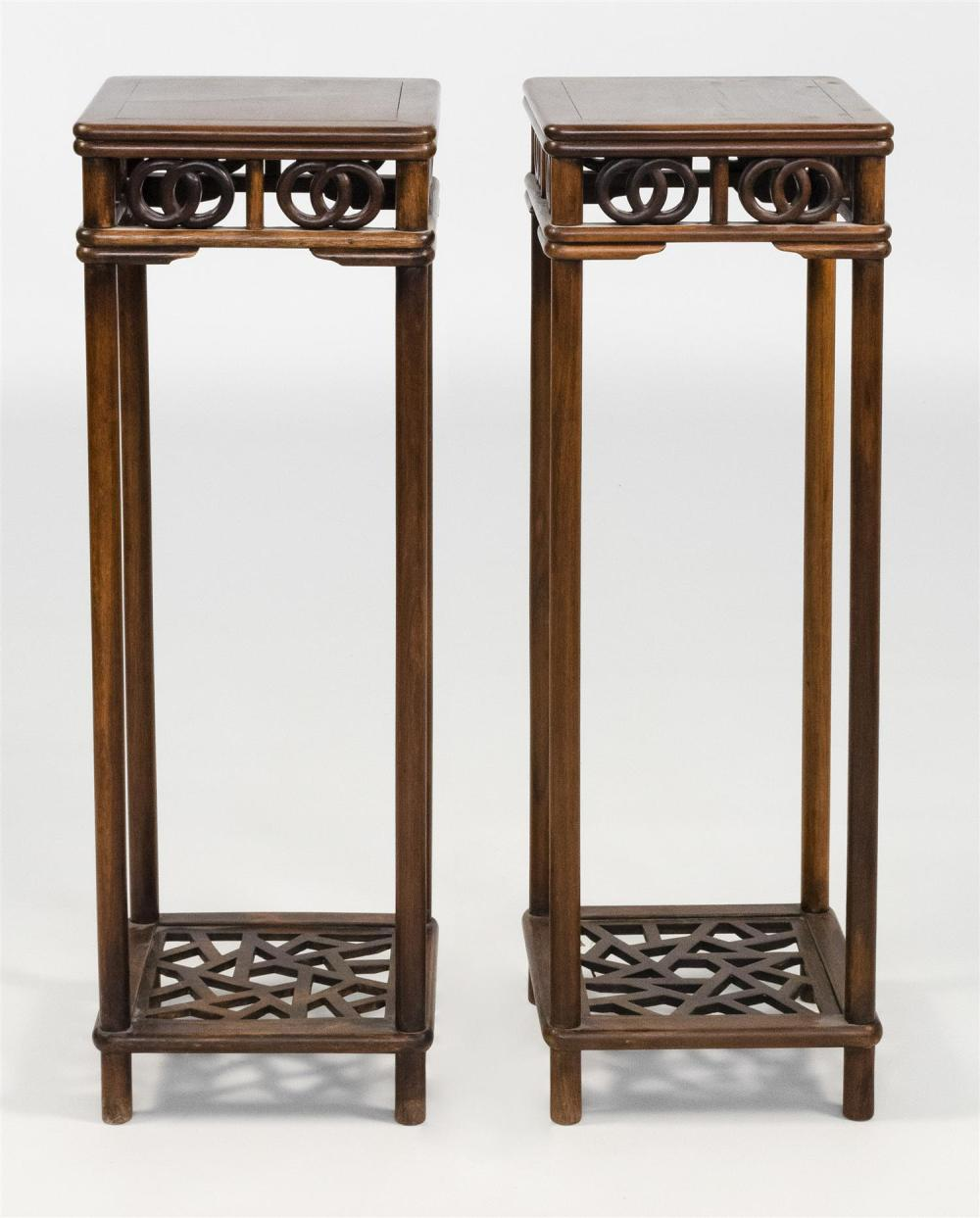 "Lot 1039: PAIR OF CHINESE ELMWOOD TALL STANDS With openwork aprons and cracked ice shelf at foot. Heights 35.5"". Tops 11.75"" x 11.75""."