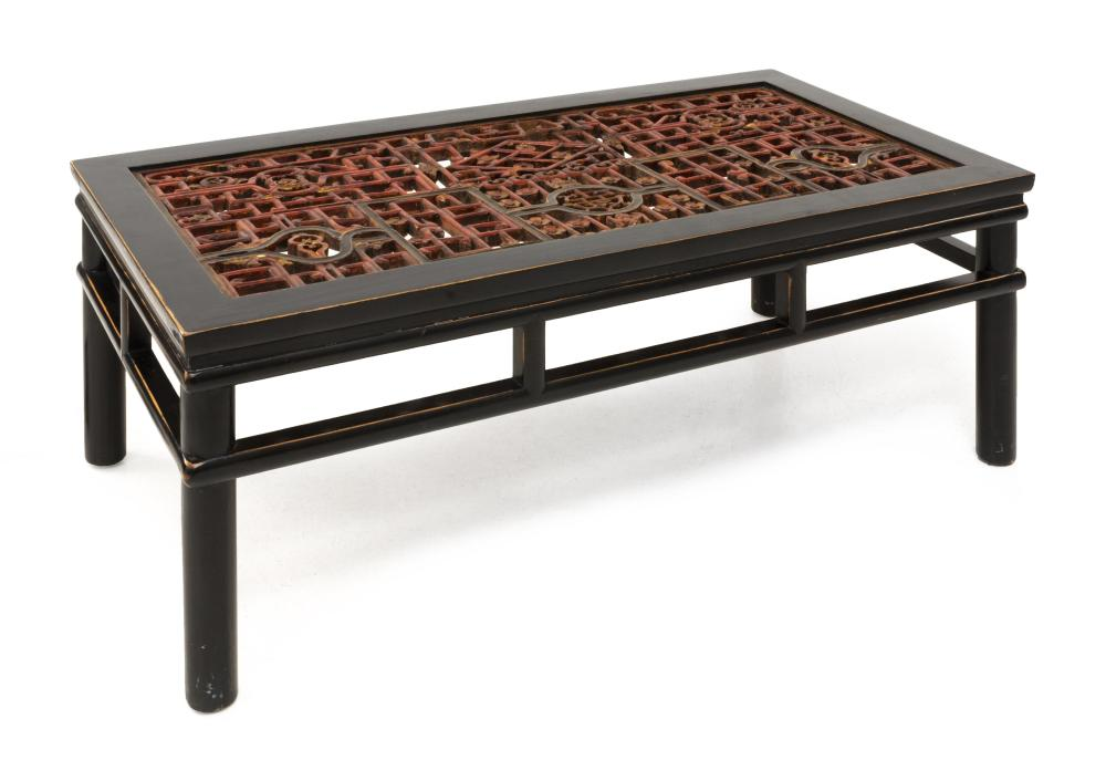 "CHINESE LOW TABLE With red, gold and black latticework top, openwork apron and turned legs. Height 19"". Top 49"" x 25""."