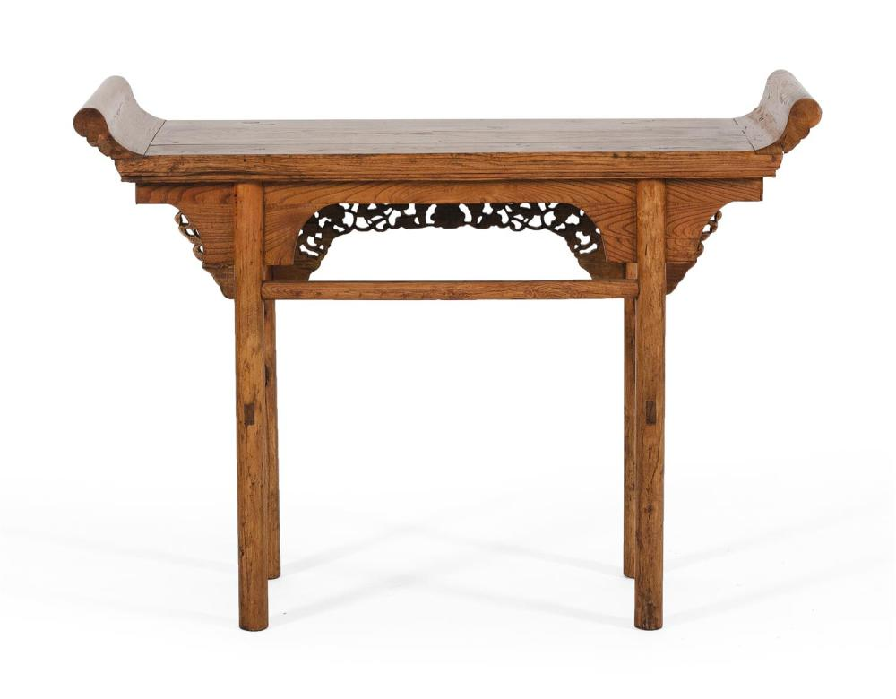 "Lot 1043: CHINESE ELMWOOD ALTAR TABLE With carved fruit and foliate apron. Height 37"". Width 47"". Depth 17""."