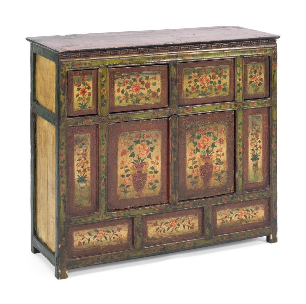 Lot 1044: TIBETAN PAINTED WOOD CHEST Paneled front with two doors above a two-door cupboard. Painted floral decoration throughout. Top painted...