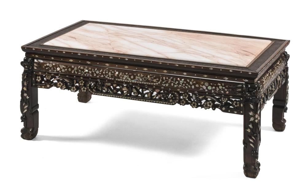 CHINESE CARVED ROSEWOOD LOW TABLE With mother-of-pearl floral inlay. Replaced pink marble top with a stippled wood surround. Carved...
