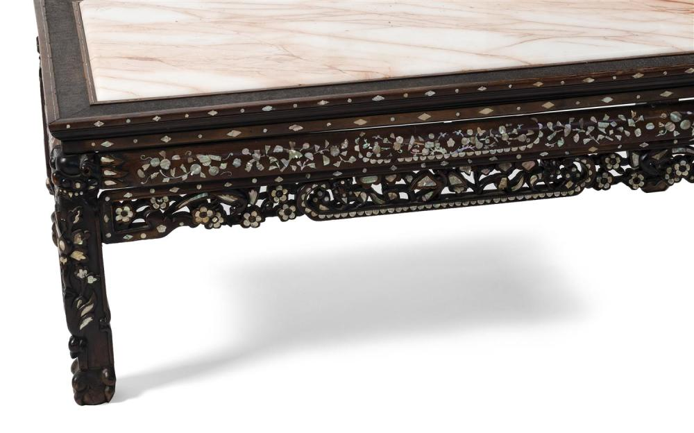 Lot 1049: CHINESE CARVED ROSEWOOD LOW TABLE With mother-of-pearl floral inlay. Replaced pink marble top with a stippled wood surround. Carved...