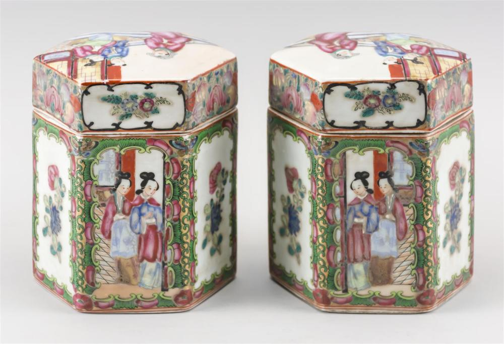 PAIR OF CHINESE EXPORT ROSE MEDALLION PORCELAIN CANISTERS In hexagonal cylindrical form, with alternating figural and floral panels....