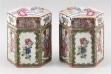 Lot 1051: PAIR OF CHINESE EXPORT ROSE MEDALLION PORCELAIN CANISTERS In hexagonal cylindrical form, with alternating figural and floral panels....