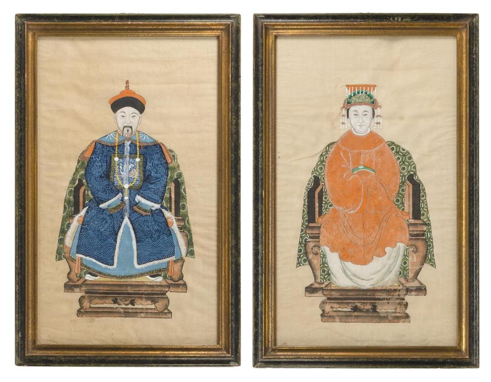 "TWO CHINESE DIMINUTIVE ANCESTRAL PORTRAITS ON SILK Depicting a man in a blue robe and a woman in a red robe. Framed 25"" x 16""."