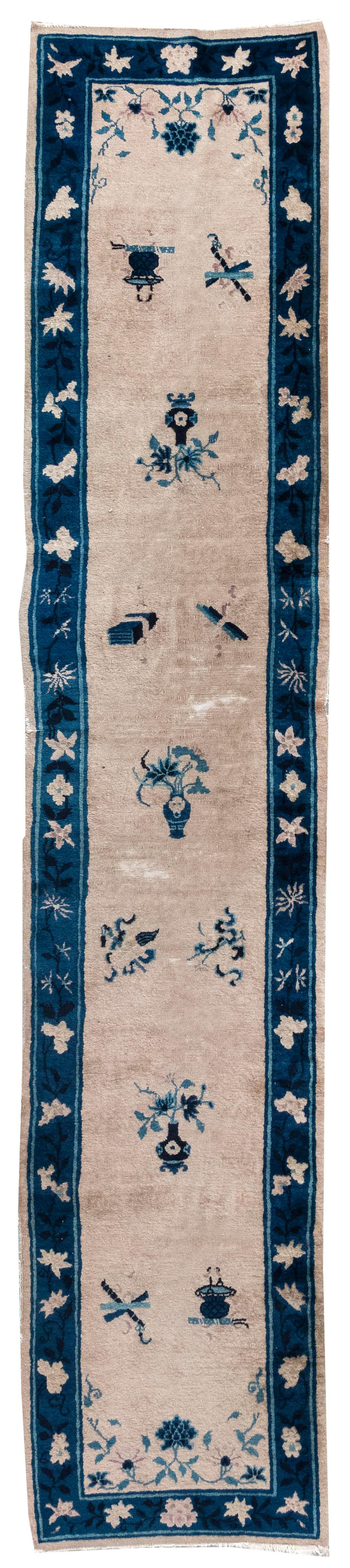 """Lot 1124: ORIENTAL RUG: CHINESE 2'7"""" x 12'8"""" Ivory field with scattered symbolic elements and blue flower vases. Blue border with vines and bl."""