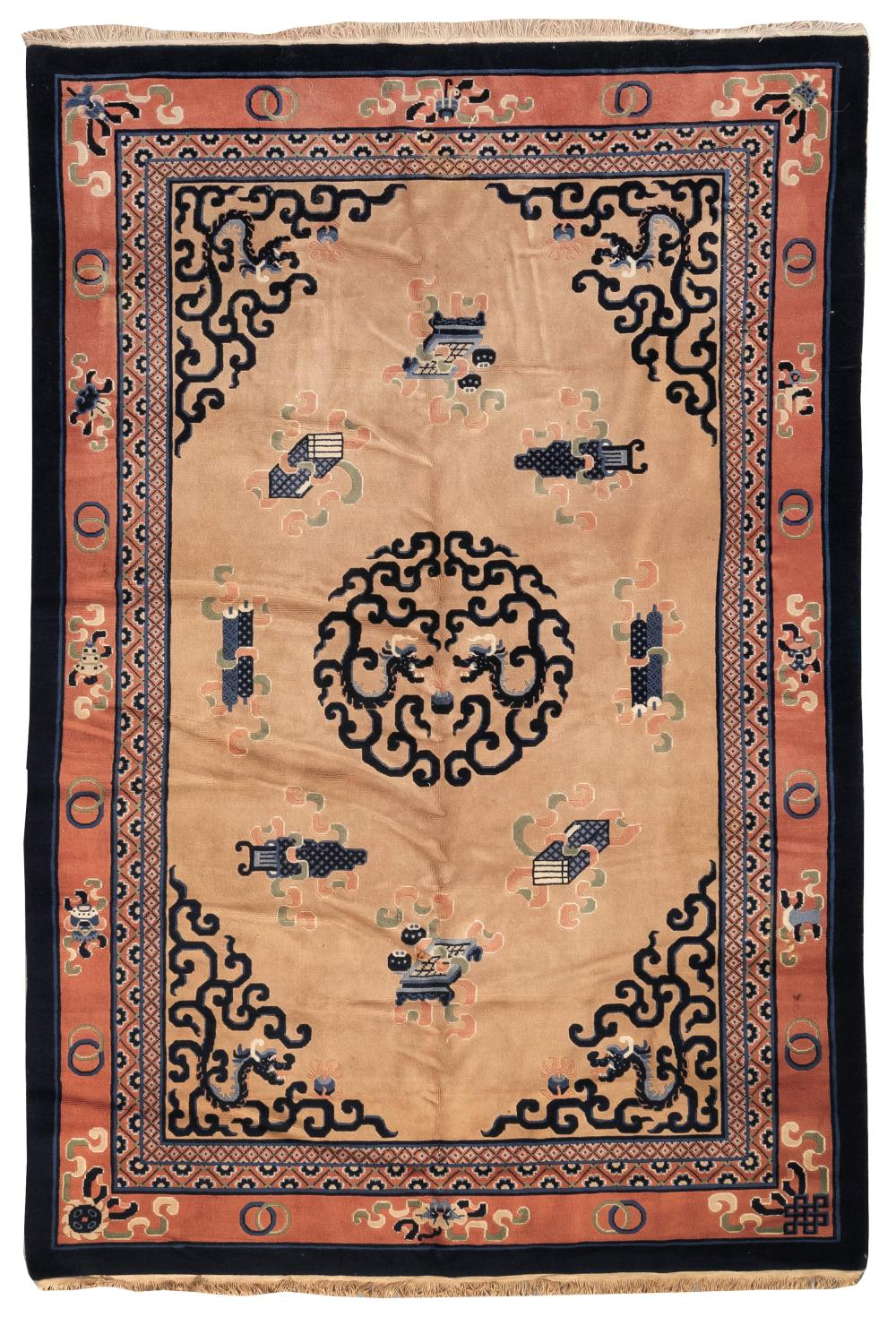 "Lot 1126: ORIENTAL RUG: CHINESE 6'0"" x 9'0"" Central medallion composed of two dark blue dragons chasing a pearl. Tan field with clouds and sym."