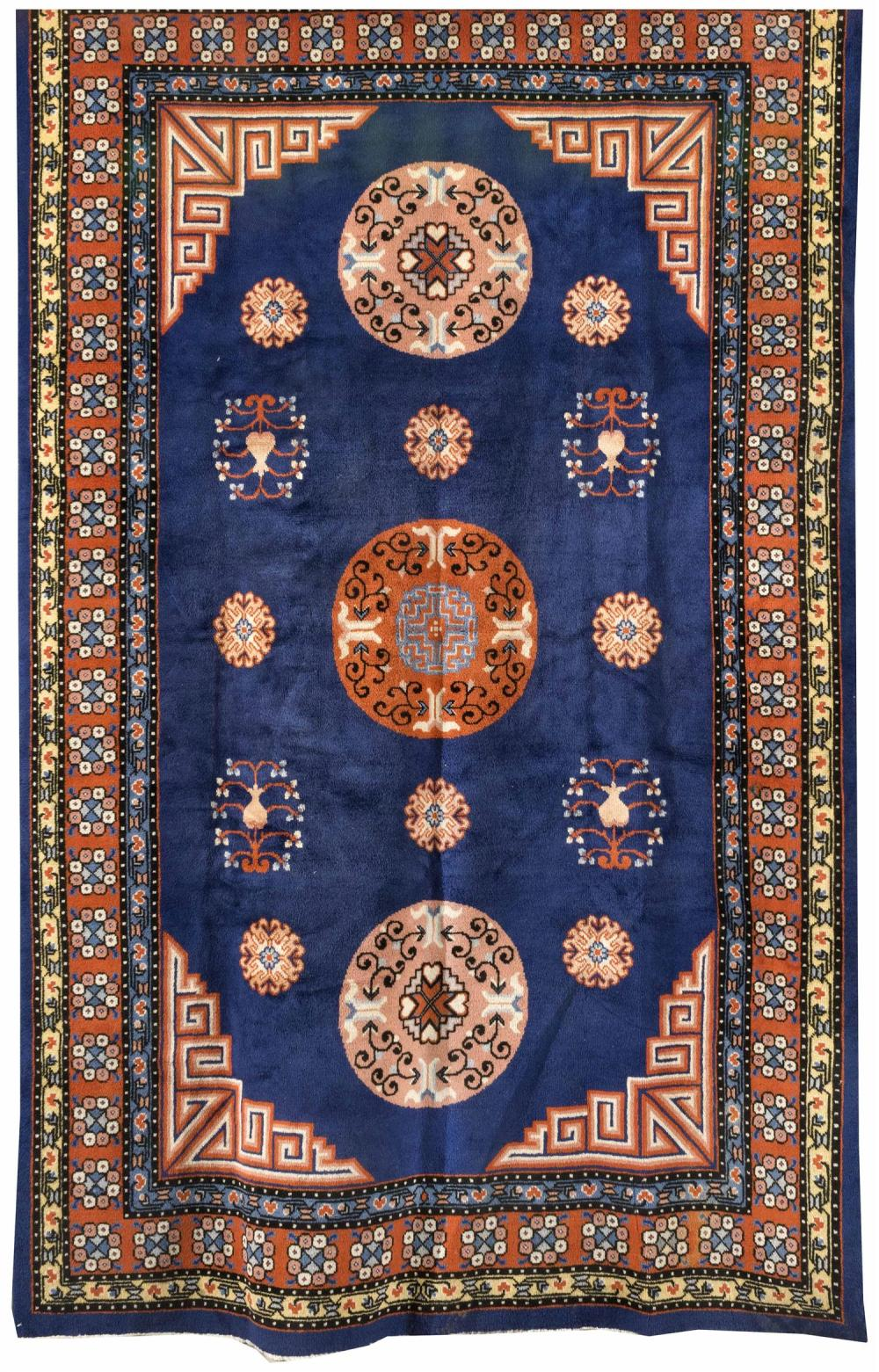 """Lot 1129: ORIENTAL RUG: CHINESE 6'0"""" x 9""""0"""" Three traditional pink and rust red rondel medallions contain and are surrounded by additional ron.."""