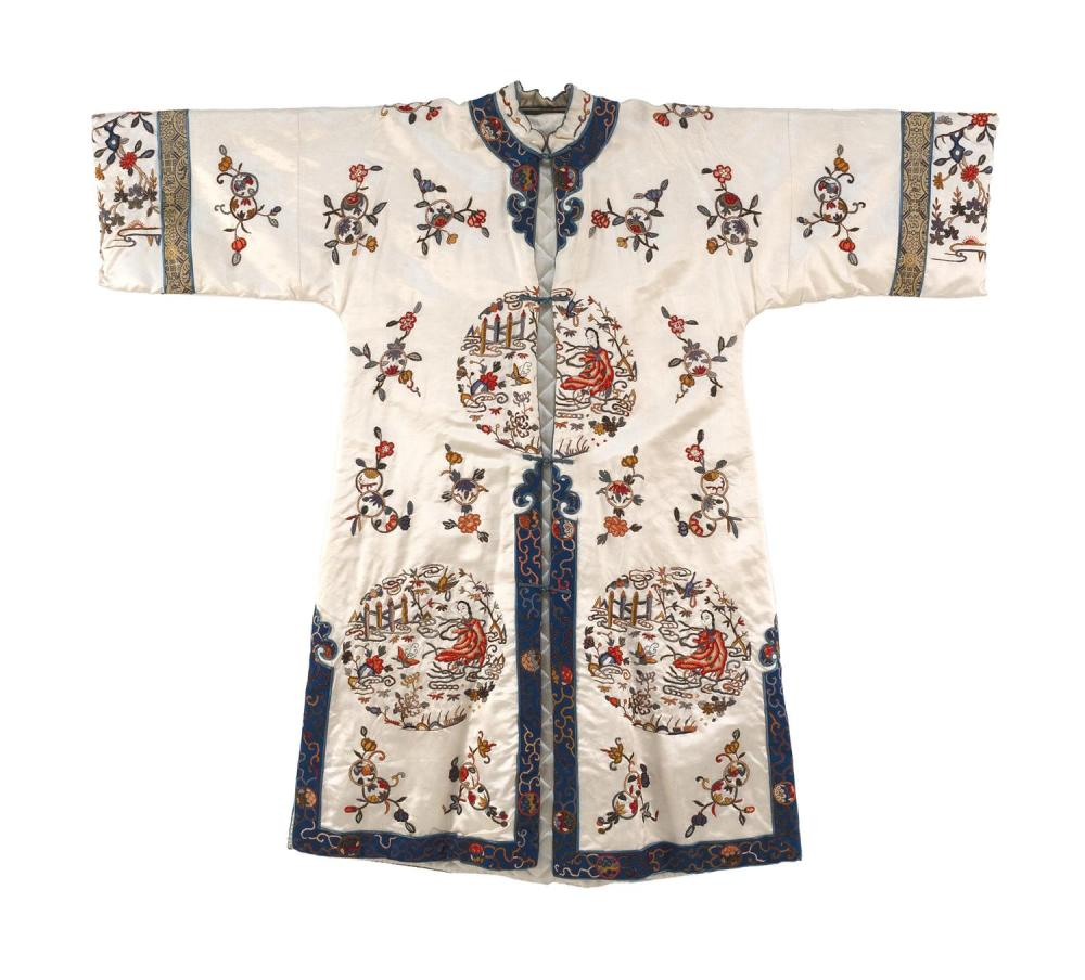 Lot 1133: CHINESE SILK NEEDLEWORK ROBE With figural rondel design on a cream ground.