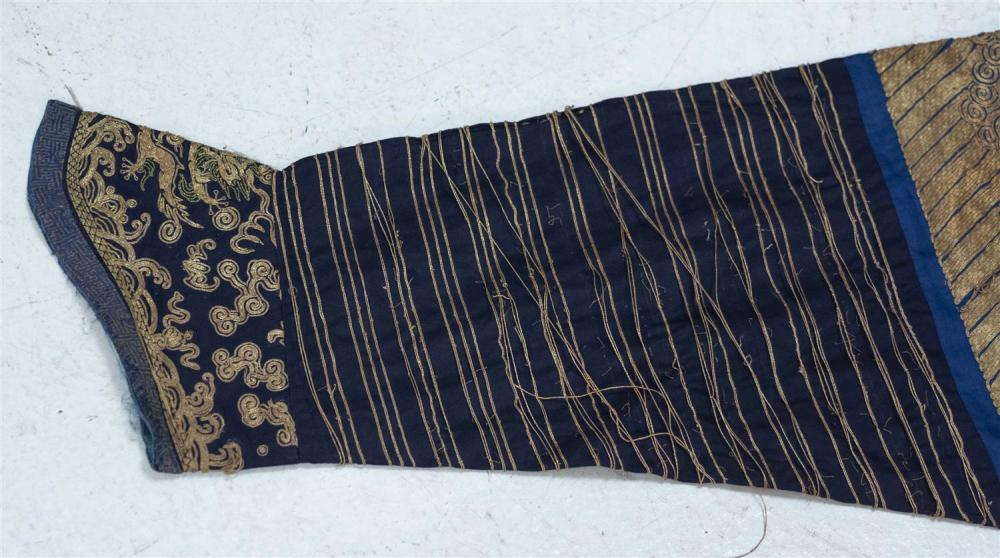 Lot 1138: CHINESE GOLD THREADWORK AND SILK NINE-DRAGON ROBE With three-tone gold five-clawed dragons on a blue ground.