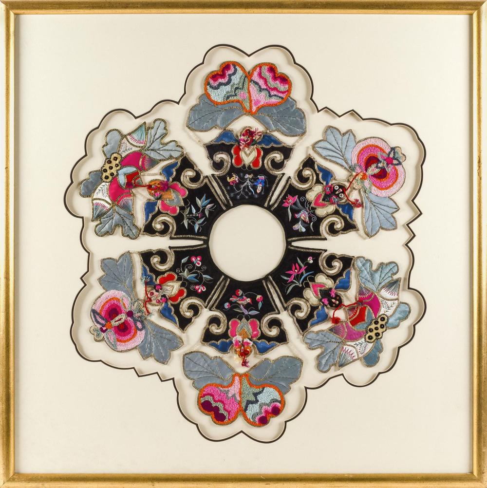 """Lot 1147: CHINESE SILK NEEDLEWORK COLLAR In flower form, with bird and flower elements about a black center. Diameter 25"""". Framed 32.5"""" x 32.5""""."""