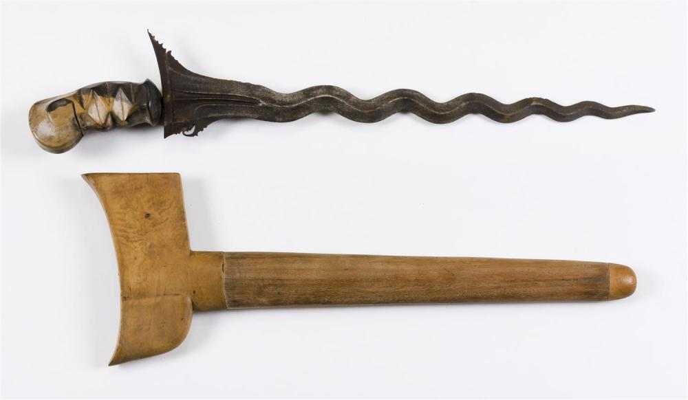 """Lot 1168: INDONESIAN KRIS Wood handle and scabbard. Serpentine blade. Overall length 19.25""""."""