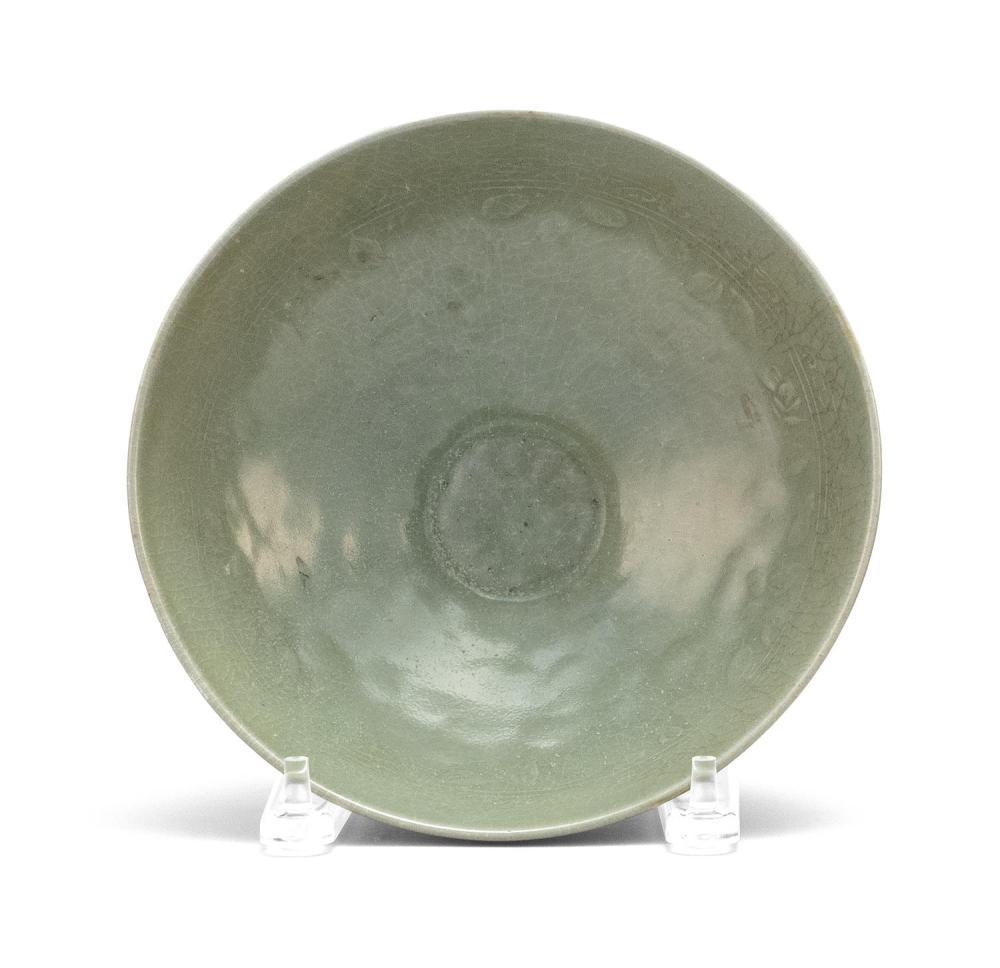 "Lot 1178: KOREAN CELADON STONEWARE BOWL In hemisphere form, with incised fret and flower designs. Diameter 7.75""."